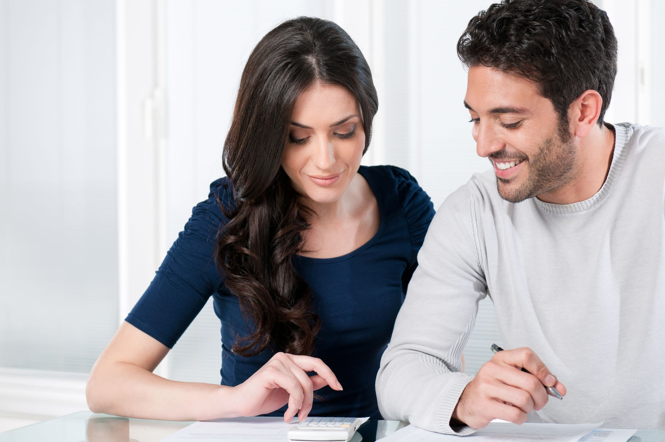 8590250 - happy smiling couple calculating their financial investments at home